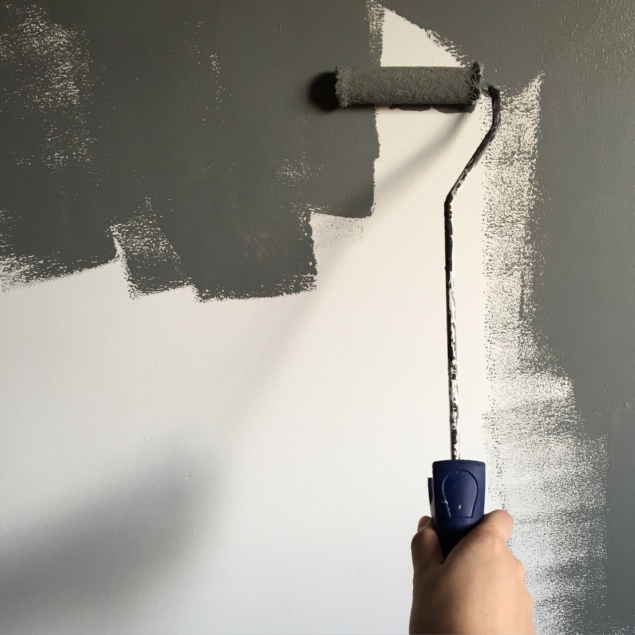 commercial wall being painted dark grey